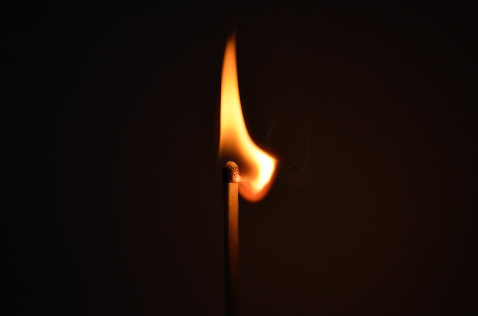A match burning with fire